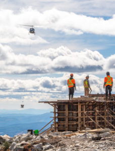 Valhalla helicopter slings concrete at big white ski hill
