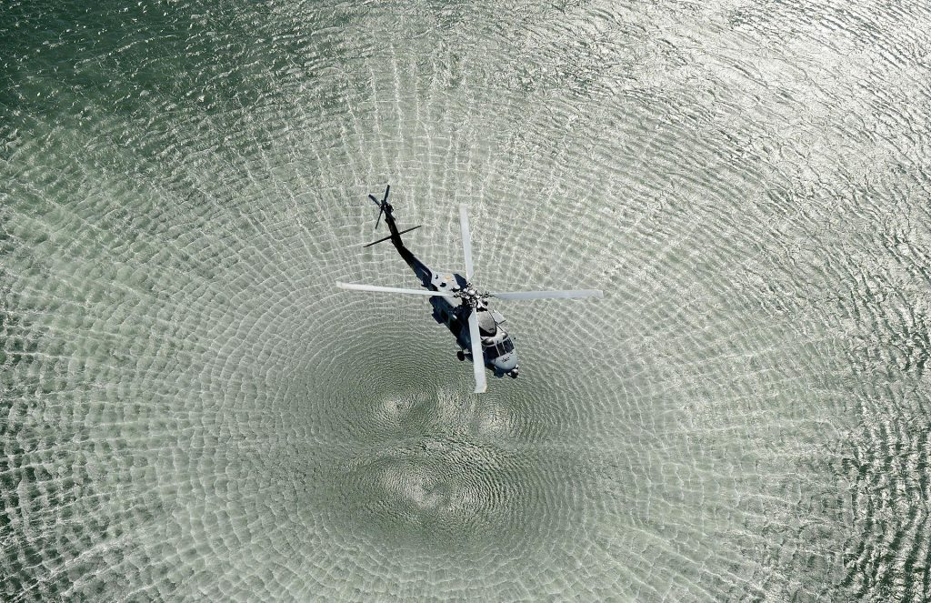 helicopter hovering over water