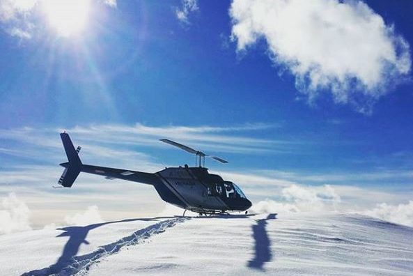 Valhalla Helicopter on snowy mountaintop