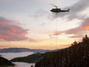 BC heli logging at sunset