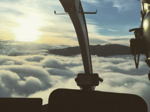 clouds and peaks from helicopter cockpit