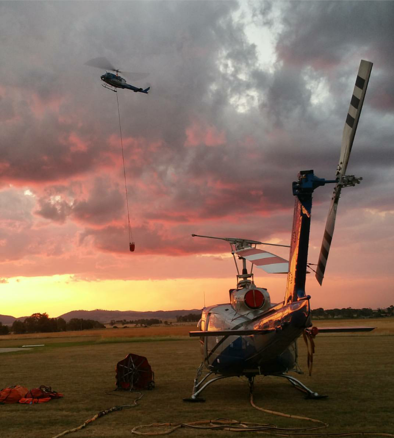 helicopters in Australia at sunset