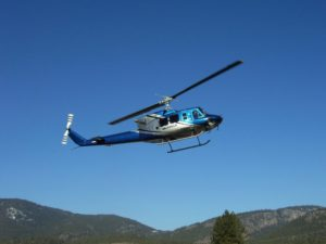 Valhalla Helicopter in the sky over the Okanagan