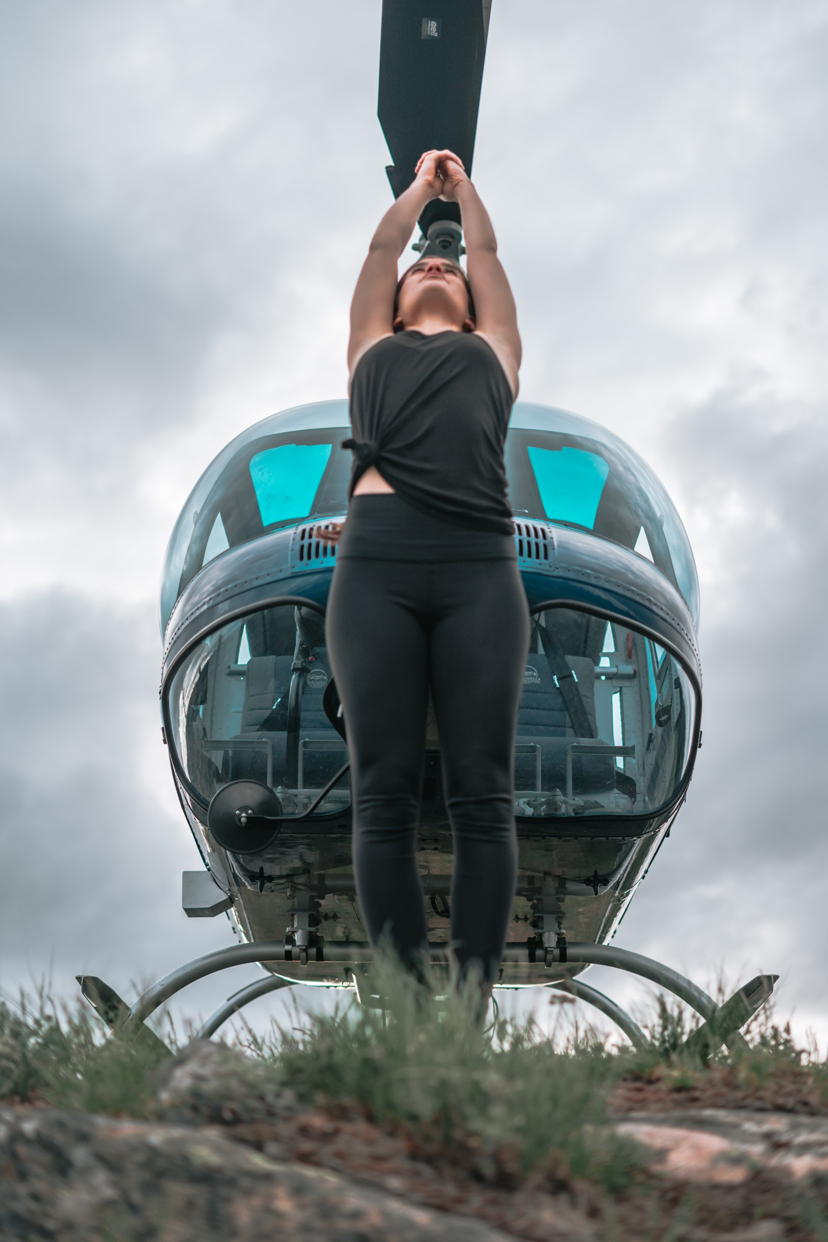 woman stretches with valhalla helicopter