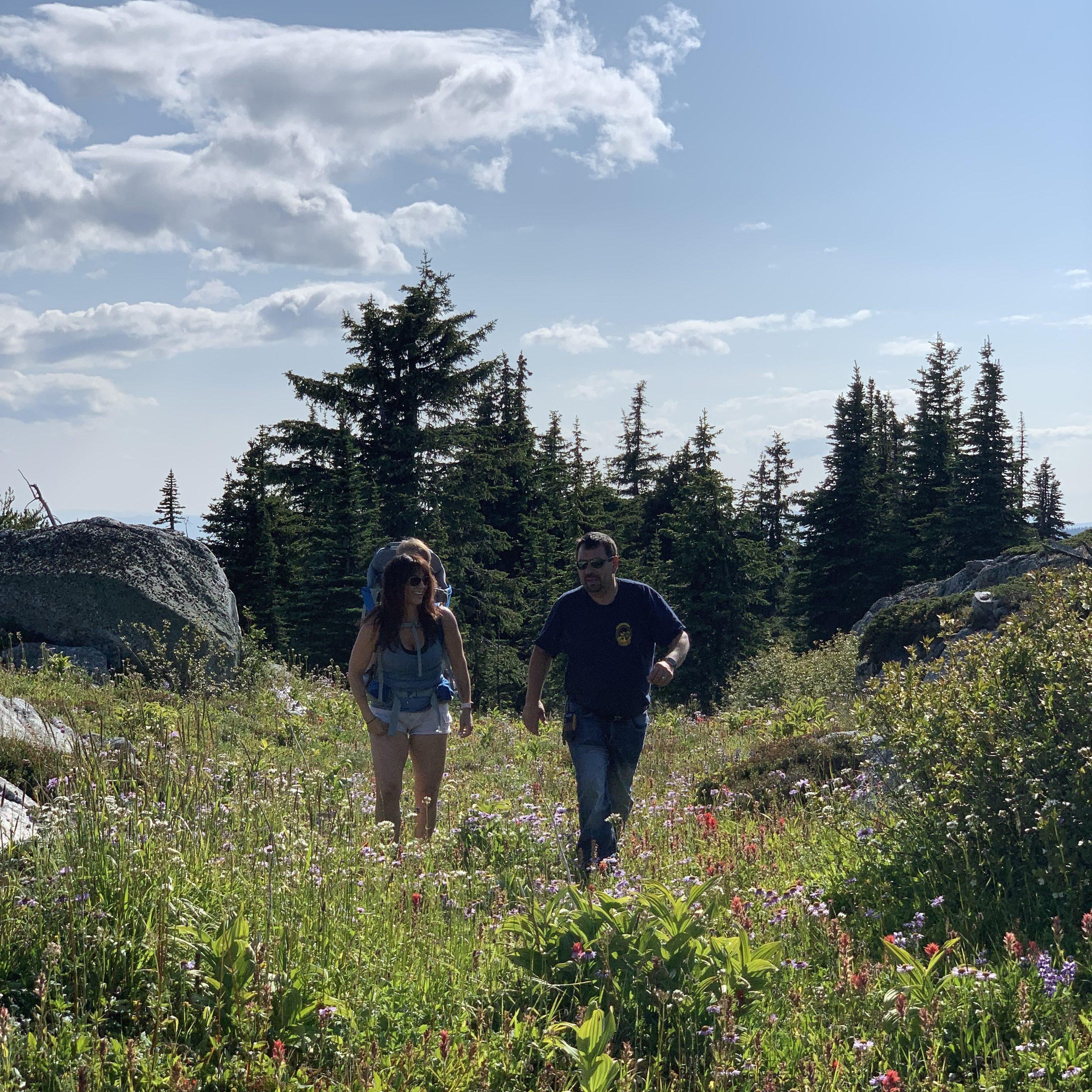 a family hikes through Kelowna alpine meadow