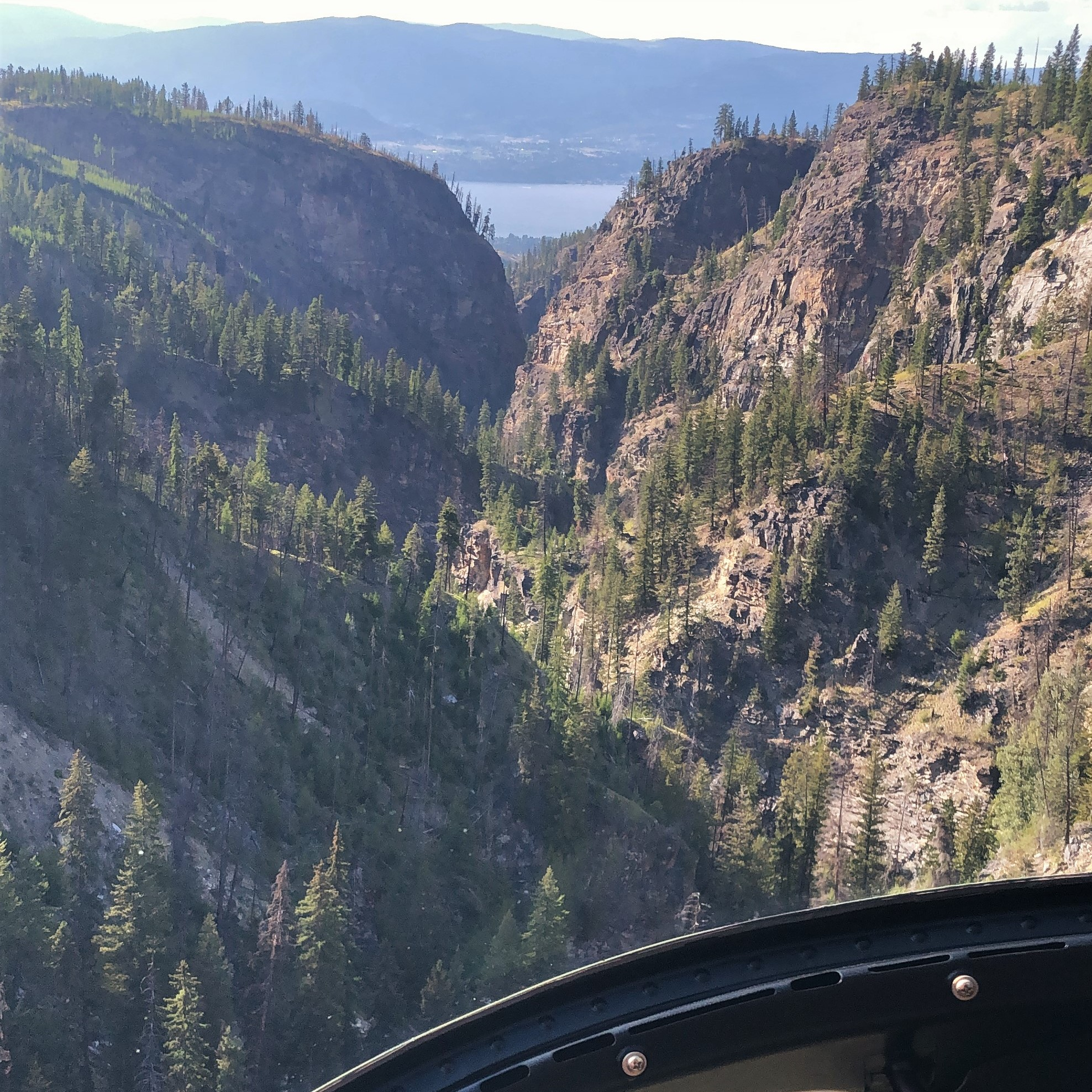 view through canyon to Okanagan Lake from helicopter