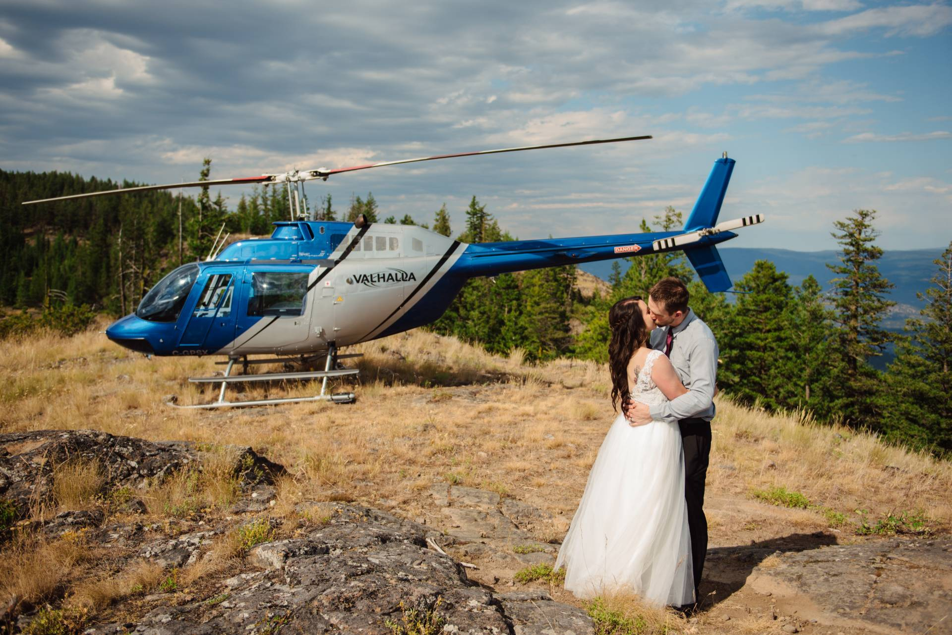Unique wedding ideas - helciopter wedding day picture next to a helicopter
